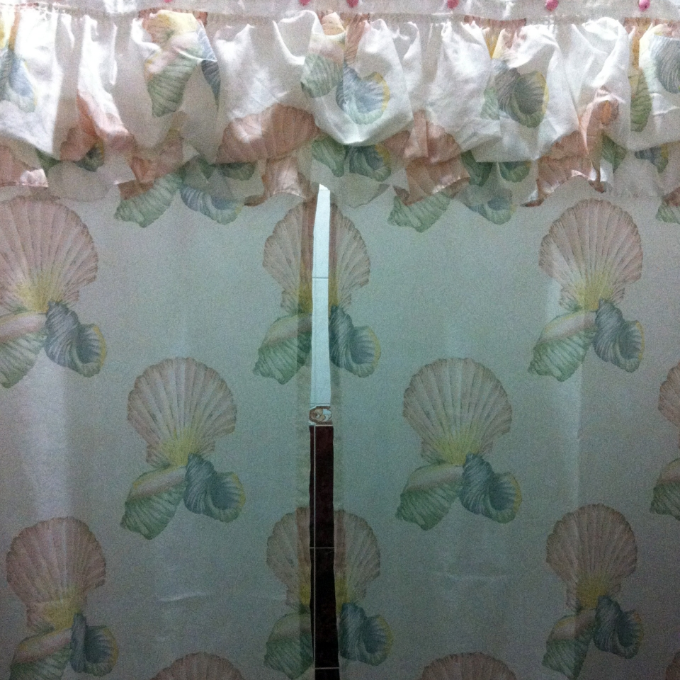 Shell-themed shower curtains with ruffles