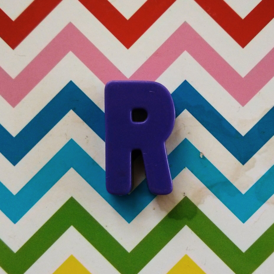 Purple R on coaster